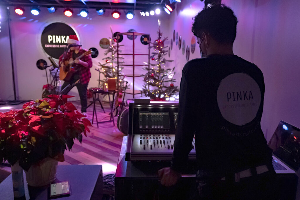 Wendell Rivera Diaz, Pinka's resident audio engineer, manning the DiGiCo S21 for a holiday performance by local singer-songwriter Scotty Long