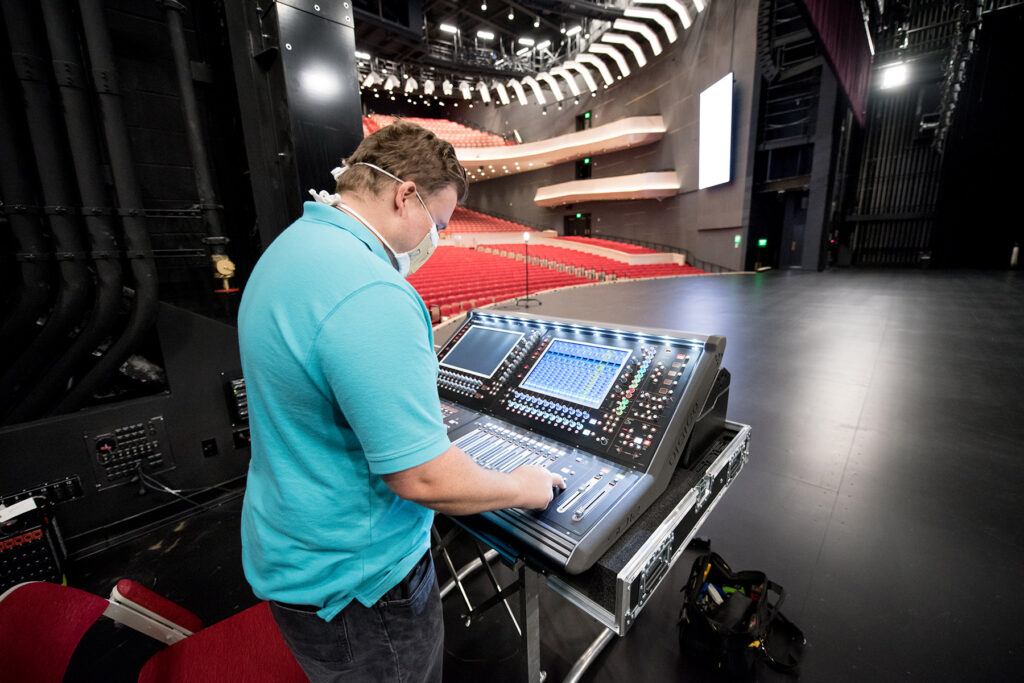Tanger Center House Tech Matt Buie-Nervik at the DiGiCo SD12 monitor mixing console located at stage left
