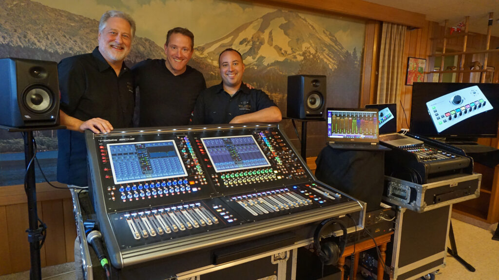 Left to right: Loren Wiklander, Matt Larson (Group One Ltd), and Matt Guzy pictured with a DiGiCo SD12 mixing console